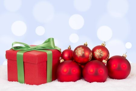 christmas gift: Christmas card gift decoration with red balls and copyspace for your own text