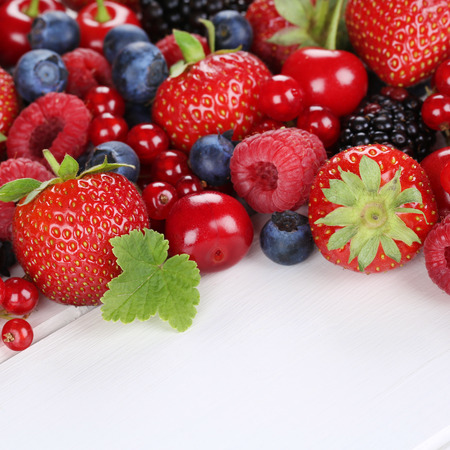 raspberries: Berry fruits with strawberries, blueberries, red currants, cherries, raspberries, blackberries on wood