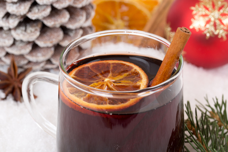 punch spice: Closeup mulled wine on Christmas in winter drinking alcohol drink decoration with snow