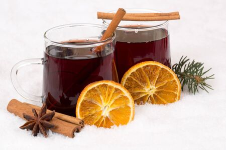 Mulled wine drinking on Christmas in winter alcohol drink in snow