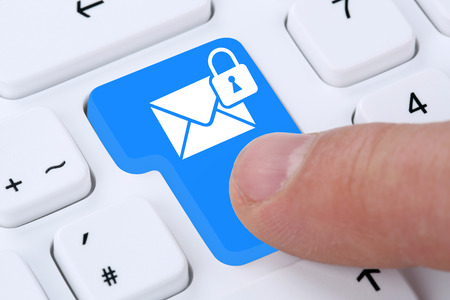 Sending encrypted secure E-Mail email mail message on computer Stock Photo