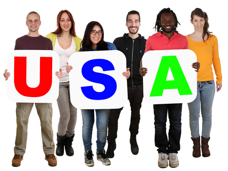 united states: Smiling group of young multi ethnic people holding word USA isolated on white Stock Photo