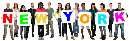 multi racial: Smiling group of young multi ethnic people holding word New York isolated on white Stock Photo
