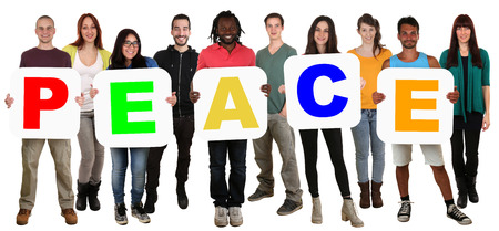 multi racial: Smiling group of young multi ethnic people holding word peace isolated on white