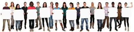 multi cultural: Smiling group of young multi ethnic people holding copyspace for ten letter or text isolated on white