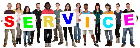 cultural diversity: Smiling group of young multi ethnic people holding word service isolated on white Stock Photo