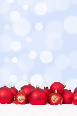 christmas balls: Christmas red balls decoration ornaments with copyspace and snow Stock Photo
