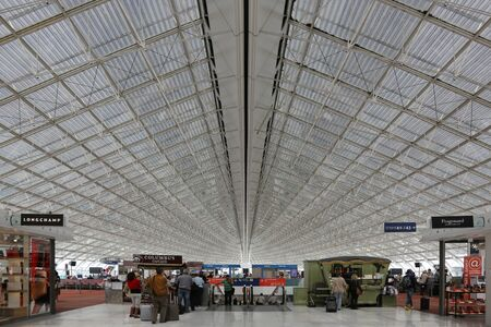 gaulle: Paris, France - May 23, 2015: Overview of Paris Charles de Gaulle International Airport Terminal 2 Hall F (CDG) in Paris, France. Paris CDG airport is the second busiest airport in Europe and the busiest in France.