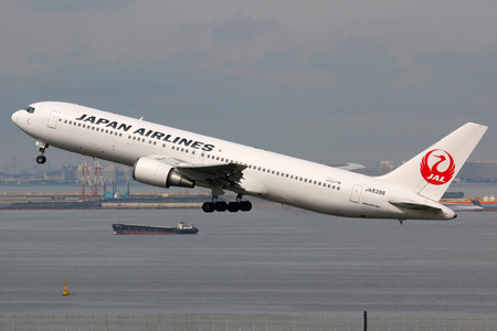 air: Tokyo, Japan - May 27, 2014: A Japan Airlines Boeing 767-300 with the registration JA8398 taking off at Tokyo Haneda Airport (HND) in Japan. Japan Airlines is the second largest Japanese airline headquartered at Tokyo Haneda airport.