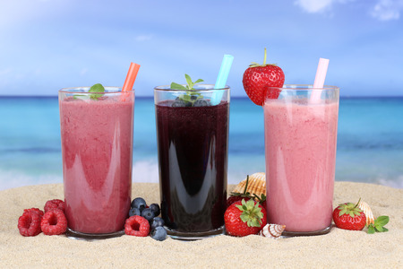 strawberry smoothie: Smoothies fruit juice with fruits smoothie in summer on the beach