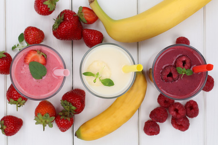 fruits juice: Smoothie fruit juice with fruits like strawberries, raspberries and banana in glass from above