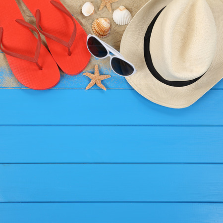 Beach scene in summer on vacation with shells, hat, sandals, copyspace