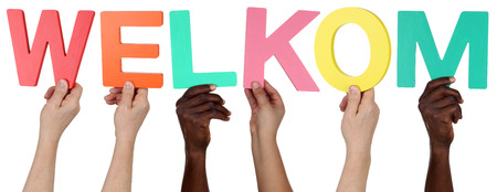 multi racial group: Multi ethnic group of people holding the Dutch word welkom welcome isolated Stock Photo