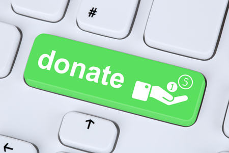 money symbol: Donate money donation for a project symbol on computer keyboard