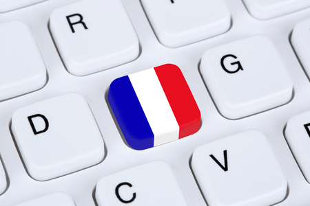computers online: France flag online internet on computer keyboard Stock Photo