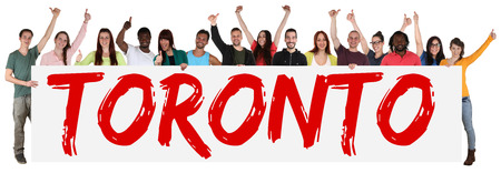 multi racial groups: Toronto group of young multi ethnic people holding banner isolated Stock Photo