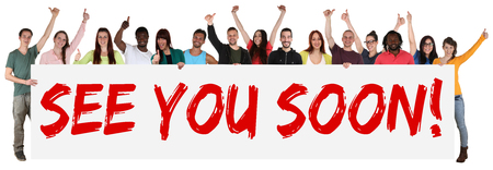 See you soon sign group of young multi ethnic people holding banner isolated Standard-Bild