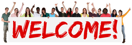 multi racial group: Welcome sign group of young multi ethnic people holding banner isolated