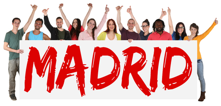 multi racial groups: Madrid group of young multi ethnic people holding banner isolated Stock Photo