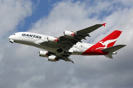28: London Heathrow, United Kingdom - August 28, 2015: A Qantas Airways Airbus A380 with the registration VH-OQB taking off from London Heathrow Airport (LHR) in the United Kingdom. The Airbus A380 is the worlds largest passenger airliner. Qantas is the flag