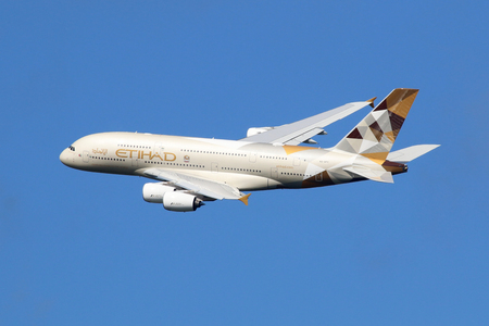 air: London Heathrow, United Kingdom - August 28, 2015: An Etihad Airways Airbus A380 with the registration A6-APC taking off from London Heathrow Airport (LHR) in the United Kingdom. The Airbus A380 is the worlds largest passenger airliner. Etihad is the fla