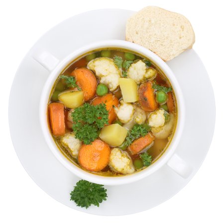 vegetable soup: Vegetable soup meal with vegetables, potatoes, carrots and peas in bowl from above isolated on a white background