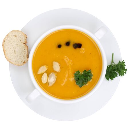 soup bowl: Pumpkin soup with fresh pumpkins in bowl from above isolated on a white background Stock Photo