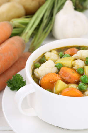 vegetable soup: Fresh soup with vegetables vegetable potatoes, carrots and peas in bowl