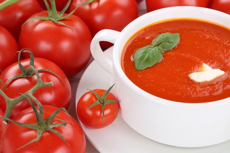 tomato soup: Tomato cream soup meal with fresh tomatoes in bowl Stock Photo