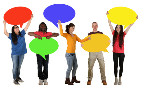 multi racial group: Group of happy young people holding empty speech bubbles with copyspace Stock Photo