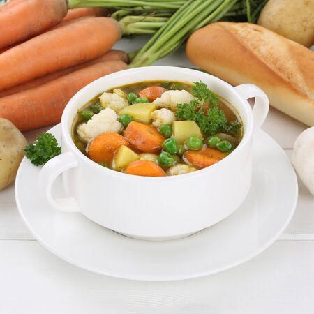 healthy eating: Vegetable soup meal with fresh vegetables, potatoes, carrots and peas in bowl healthy eating Stock Photo
