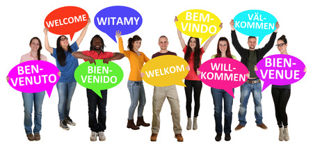 Refugees welcome in different languages group of young multi ethnic people isolated Foto de archivo