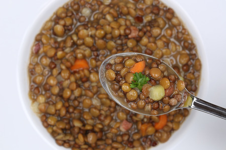 soup spoon: Eating lentil soup stew meal with lentils on spoon from above