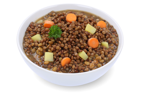 lentil: Lentil soup stew meal with lentils in bowl isolated on a white background Stock Photo