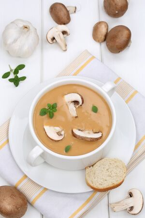mushroom soup: Mushroom soup meal food lunch with fresh mushrooms in bowl Stock Photo