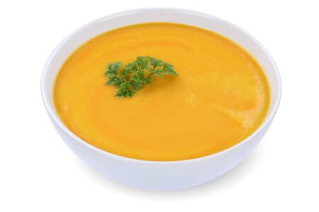 on a white background: Carrot soup meal with carrots in bowl isolated on a white background Stock Photo
