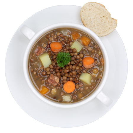on a white background: Lentil soup stew meal with lentils in bowl from above isolated on a white background