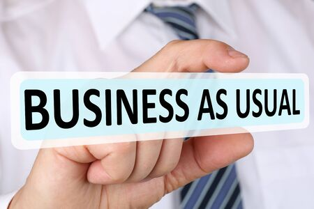 usual: Businessman business as usual concept change strategy leadership Stock Photo
