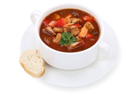 Goulash: Goulash soup meal with meat and paprika in cup isolated on a white background