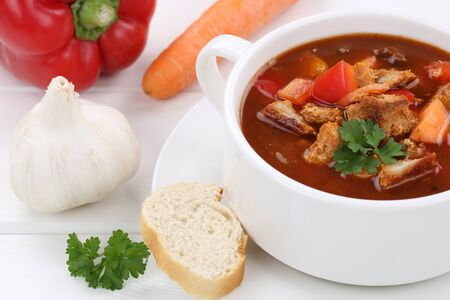 goulash: Goulash soup meal with meat, baguette in cup closeup