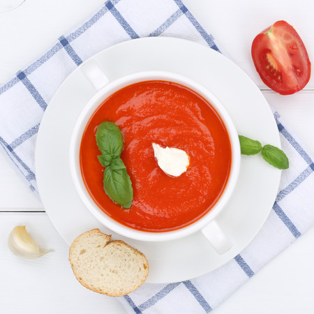 soup bowl: Tomato soup meal with fresh tomatoes in bowl from above healthy eating
