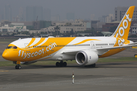 Kaohsiung, Taiwan - October 17, 2015: A Scoot Boeing 787-8 Dreamliner with the registration 9V-OFB taxis at Kaohsiung Airport (KHH) in Taiwan. The Boeing 787 Dreamliner is the worlds first major airliner to use composite materials in the construction of
