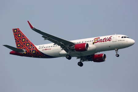 sin: Singapore - October 21, 2015: A Batik Air Airbus A320 with the registration PK-LAH on approach to Singapore Airport (SIN). Batik Air is an airline from Indonesia based at Jakarta airport. Lion Air is its parent company. Editorial