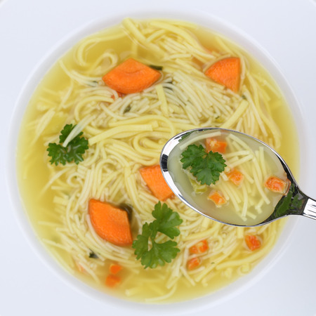 Healthy eating noodle soup meal in bowl with noodles from above and spoon