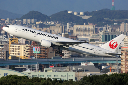 Fukuoka, Japan - October 13, 2015: A Japan Airlines Boeing 777-200 with the registration JA8977 takes off from Fukuoka Airport (FUK) in Japan. Japan Airlines is the flag carrier of Japan and the second largest Japanese airline. Editorial