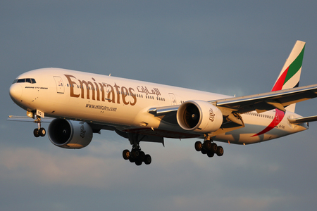 Hamburg, Germany - September 2, 2015: An Emirates Boeing 777-300ER with the registration A6-ENQ approaching Hamburg Airport (HAM) in Germany. Emirates is an airline from the United Arab Emirates based in Dubai. Editorial