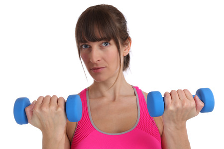 female muscle: Power strong fitness young woman at sports workout with dumbbells isolated on a white background