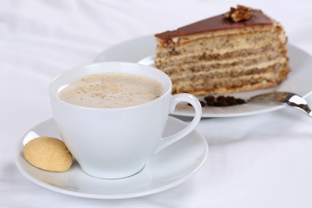 sweet pastry: Hot fresh coffee and nut cake tart dessert sweet pastry Stock Photo