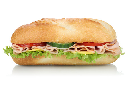 Sub deli sandwich baguette with ham, cheese, tomatoes and lettuce side view isolated on a white background