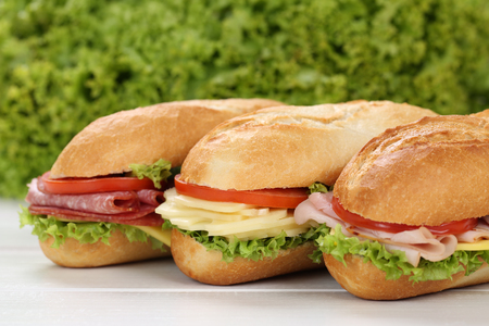 deli: Sub deli sandwiches baguettes with ham, salami, cheese, tomatoes and lettuce